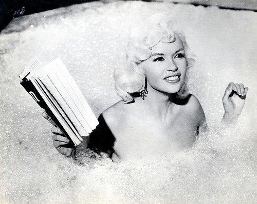 Jayne Mansfield reading in bath